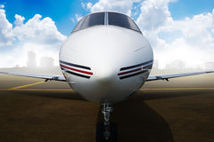 Private jet airplane parking at the airport. Stock Photos