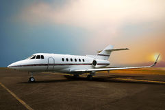 Private jet airplane parking at the airport. With sunset background stock photos