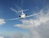 Private jet airplane in the sky Stock Photo