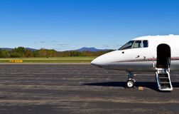 Private jet awaits you. Private jet ready for passengers at small, rural airfield Royalty Free Stock Photo