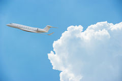 Private jet with clouds Stock Image