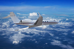 Private jet cruising in a sky Royalty Free Stock Images