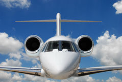 Private jet in flight. Private jet against blue sky and clouds royalty free stock photography