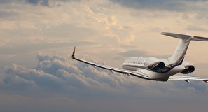 Private jet in flight. Side view stock photography