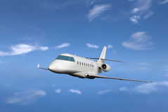 Private jet. Fly with blue sky on the background royalty free stock photography