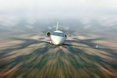 Private jet. Fly fast with blur background stock images