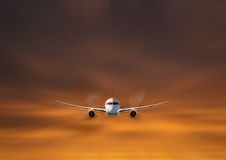 Private jet flying. A beautiful sunset and a private jet while flying Royalty Free Stock Photos