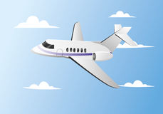 Private jet. A private jet is flying in the blue sky Stock Photos