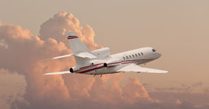 Private jet flying through clouds. Private jet flying through cloudy skies Royalty Free Stock Photos