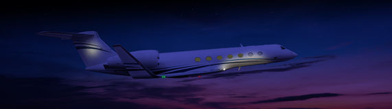 Private jet flying at night. Beautiful private jet flying at night Stock Photos