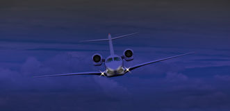 Private jet flying at night Stock Image