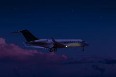 Private jet flying at night Stock Photo