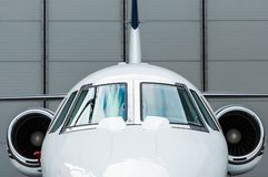 Private Jet in hangar. Luxury Business Private Jet plane at airfield toned in blue Royalty Free Stock Photo