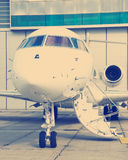 Private Jet in hangar Royalty Free Stock Photos