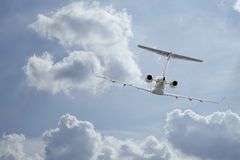 Private Jet inflight. Following a private jet flying through the clouds stock images