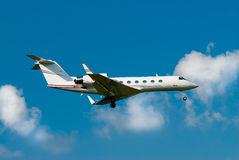 Private jet landing Stock Photo