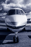 Private Jet. Luxury Corporate Business Private Jet plane at airfield toned in blue Royalty Free Stock Photo