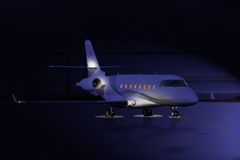 Private jet at night on the runway. With spot lights Stock Photography