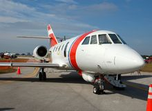 Private jet parked at airport. Luxury jet for business charter service royalty free stock image
