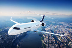 Private jet plane in the blue sky. At day stock photography