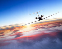 Private jet plane flying above clouds Royalty Free Stock Image
