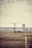 Private jet plane parking at the airport. Private airplane at orange sunset. Royalty Free Stock Image