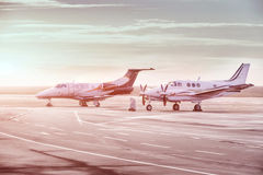 Private jet planes parking at the airport. Private airplanes at sunset,. Private jet planes parking at the airport. Business aircrafts at sunset stock photography