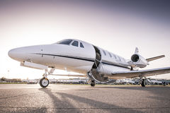 Private jet ready for boarding. Luxury business jet with open door ready for passenger boarding stock photography