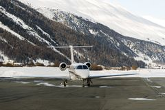 A private jet is ready to take off in the airport of St moritz in the alps switzerland in winter Royalty Free Stock Image