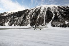 A private jet is ready to take off in the airport of St moritz in the alps switzerland in winter Stock Photography