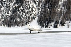 A private jet is ready to take off in the airport of St moritz in the alps switzerland in winter Stock Photos