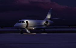 Private jet sitting at the tarmac Stock Photos