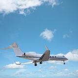 Private jet in a sky Stock Photo