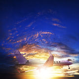 Private jet in sunset sky Stock Photo