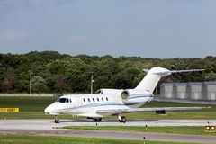 Private jet taxiing for departure. A private jet aircraft taxiing for departure at an executive airport in the Chicago area royalty free stock photography