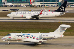 Private Jet vs. Passenger Jet Royalty Free Stock Image