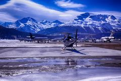 Private jets and a helicopter in the airport of St Moritz Switzerland Stock Image