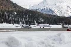 Private jets, planes and aircrafts in the snow covered landscape and mountains in the alps switzerland Stock Photography