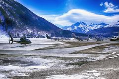 Private jets, planes and helicopters in the beautiful snow covered mountains of alps in St Moritz Switzerland. Xxx Royalty Free Stock Photos