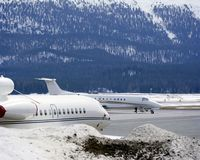 Private jets, planes and in the snow covered landscape of Switzerland Royalty Free Stock Image