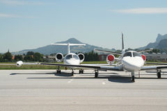 Private jets in Salzburg, Austria. Private jets on ramp in Salzburg, Austria Royalty Free Stock Images