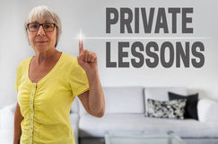 Private Lessons touchscreen is shown by senior Stock Image