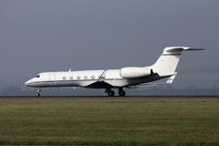 Private luxury jet on runway. Stock Image