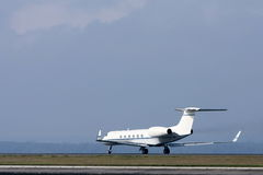 Private luxury jet on runway. Private luxury jet on runway, ready for takeoff Royalty Free Stock Photo