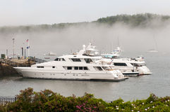 Private luxury yachts in fog Royalty Free Stock Photography