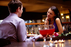 Private meeting. Pretty woman admires man at meeting Stock Images
