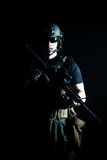 Private military contractor PMC. With assault rifle on dark background Stock Image