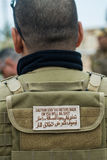 Private military contractor. Warning signal on a tactical vest owned a private military contractor Stock Images