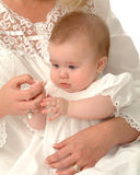 Private Moment. Baby being held by mother while holding hands Stock Image