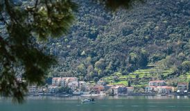 Motorboat on the Kotor Bay. Private motor boat swimming on the waters of Kotor Bay, Montenegro royalty free stock photos
